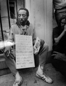 Writer and social activist Dick Gregory holding signs during a protest 1972