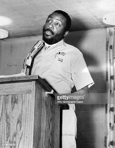 Writer and social activist Dick Gregory speaking at a podium 1968