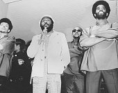 Writer and social activist Dick Gregory wearing hat speaking to the crowd during a Black Panther event New Jersey November 2 1968