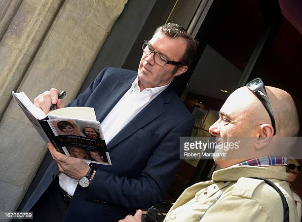 Writer Andrew Morton autographs his latest book 'Ladies of Spain' for a fan during Sant Jordi day celebrations on April 23 2013 in Barcelona Spain...