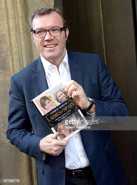 Writer Andrew Morton poses with his latest book 'Ladies of Spain' during Sant Jordi day celebrations on April 23 2013 in Barcelona Spain Sant Jordi...