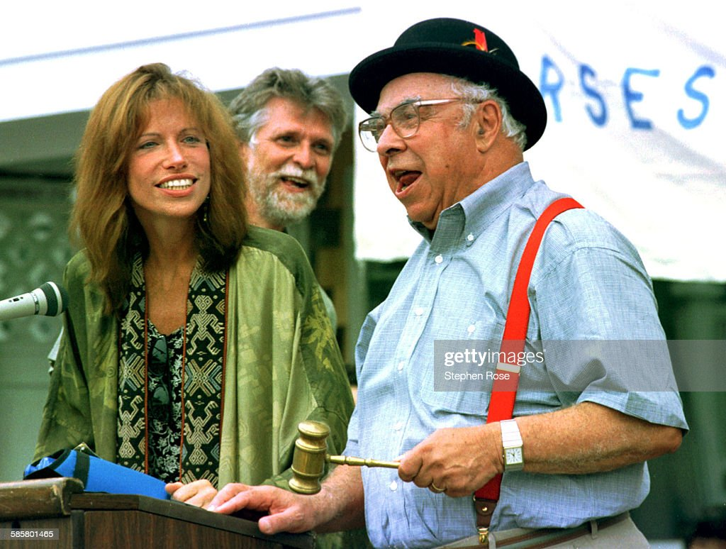 Writer <a gi-track='captionPersonalityLinkClicked' href=/galleries/search?phrase=Art+Buchwald&family=editorial&specificpeople=220909 ng-click='$event.stopPropagation()'>Art Buchwald</a> (right) and singer <a gi-track='captionPersonalityLinkClicked' href=/galleries/search?phrase=Carly+Simon&family=editorial&specificpeople=208870 ng-click='$event.stopPropagation()'>Carly Simon</a> auction an 8-mile cycling tour of Gay Head with John F. Kennedy Jr. at the Possible Dreams Auction in Edgartown, Massachusetts on Monday 5th August 1996. The bike ride sold for $12,500.00.