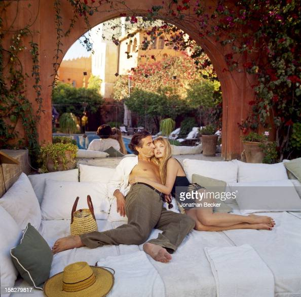 Writer BernardHenri Levy and wife/actress Arielle Dombasle are photographed for Vanity Fair Magazine on March 16 2002 poolside of their eighteenth...
