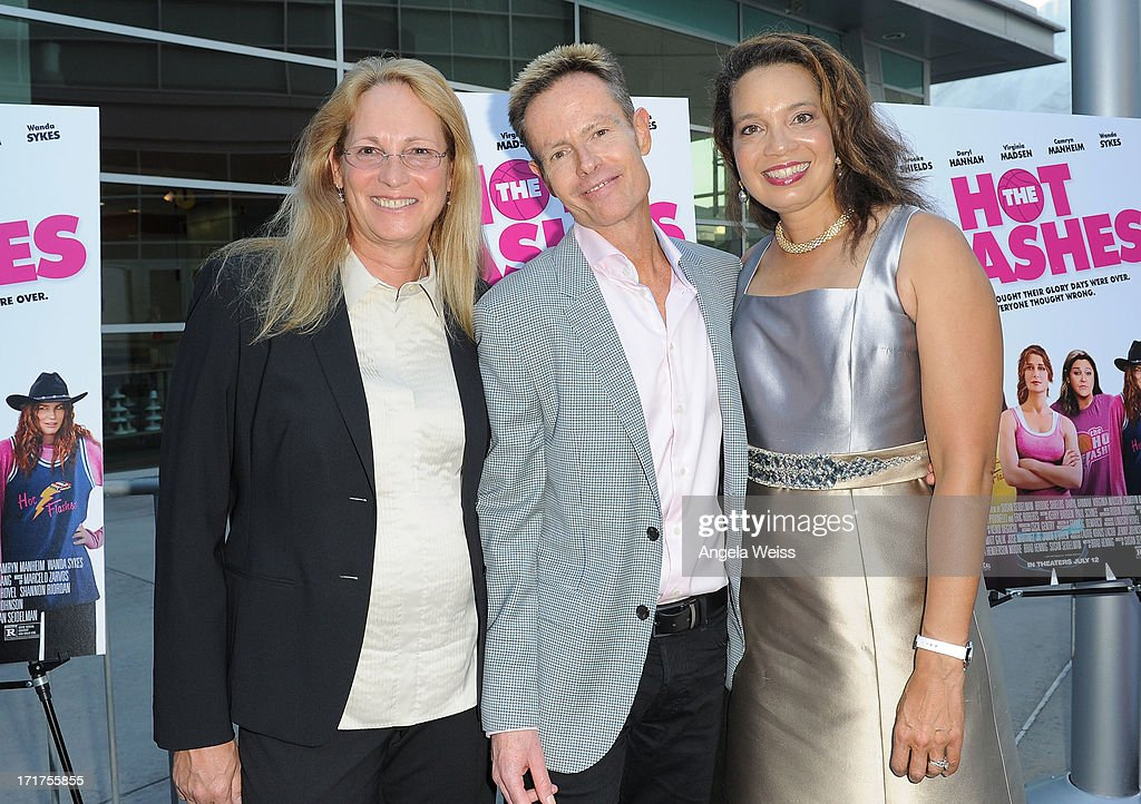 Writer Brad Hennig (C) and producer Nina Henderson Moore (R) arrive at the premiere of 'The Hot Flashes' at ArcLight Cinemas on June 27, 2013 in Hollywood, California.