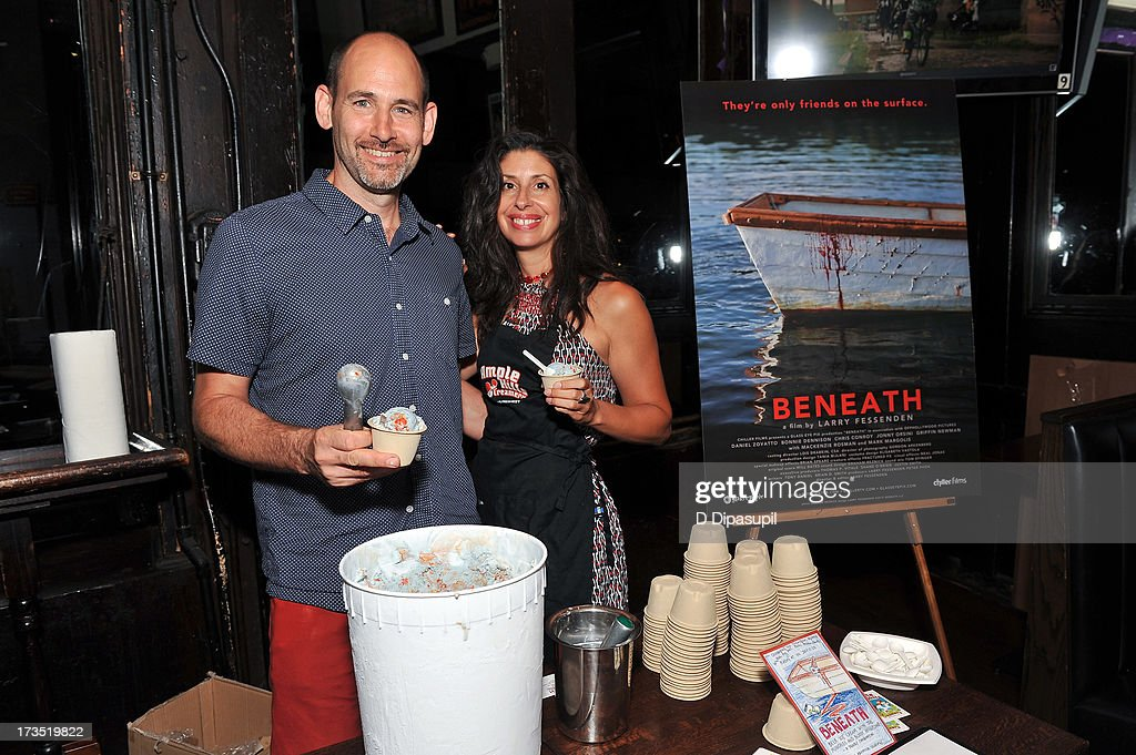 Writer Brian D. Smith (L) and wife Jackie Cuscuna serve Ample Hills Creamery ice cream during the Glass Eye Pix 'Beneath' Premiere Event - After Party at Oliver's City Tavern on July 15, 2013 in New York City.