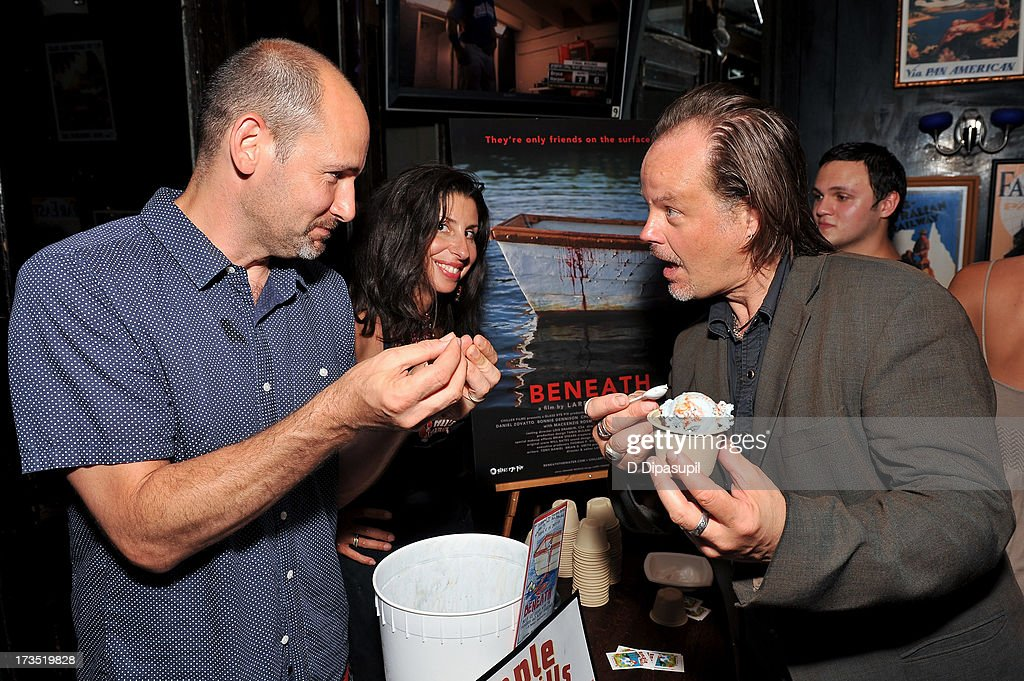Writer Brian D. Smith (L) and wife Jackie Cuscuna (C) serve Ample Hills Creamery ice cream to director Larry Fessenden during the Glass Eye Pix 'Beneath' Premiere Event - After Party at Oliver's City Tavern on July 15, 2013 in New York City.