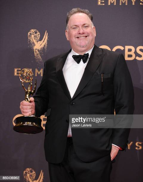 Writer Bruce Miller winner of Outstanding Writing for a Drama Series for 'The Handmaid's Tale' poses in the press room the 69th annual Primetime Emmy...