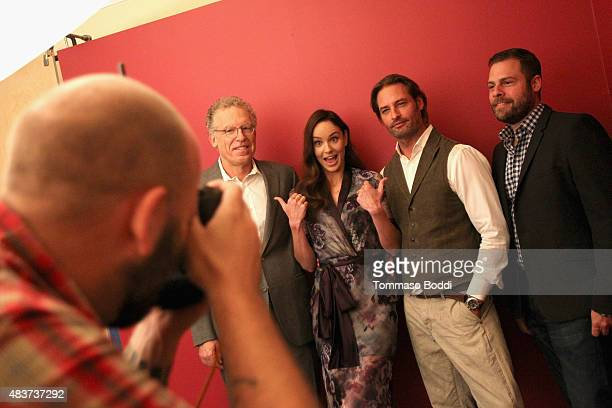 Writer Carlton Cuse actors Sarah Wayne Callies Josh Holloway and writer Ryan Condal of USA Network's 'Colony' attend Behind The Scenes Of The Getty...