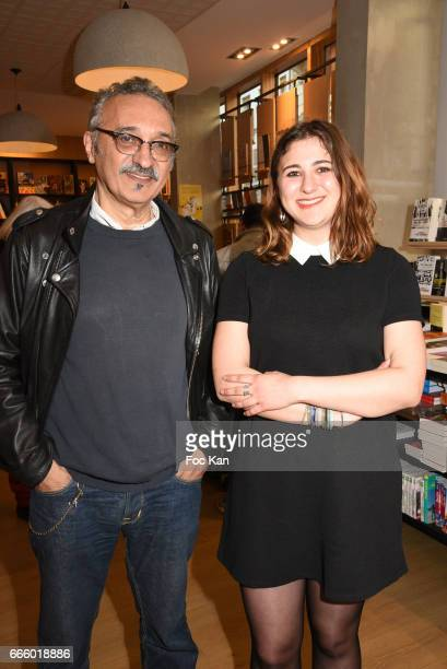 Writer Carmen Athena Bramly and her father writer Serge Bramly attend Onde de Choc' Carmen Athena Bramly Book Signing at Bookstore Les Nouveautes on...