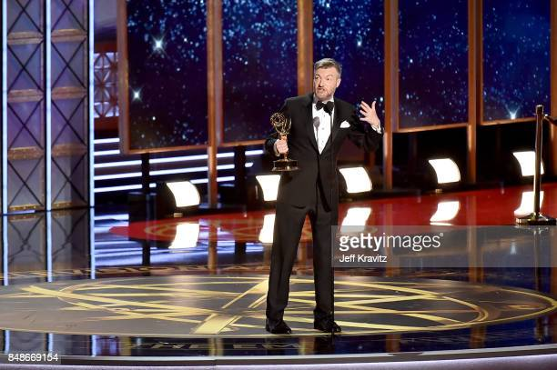 Writer Charlie Brooker accepts the Outstanding Writing for a Limited Series Movie or Dramatic Special award for 'Black Mirror San Junipero' onstage...