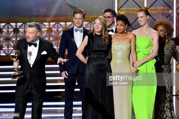 Writer Charlie Brooker with cast and crew of 'Black Mirror San Junipero' accept the Outstanding Television Movie award onstage during the 69th Annual...