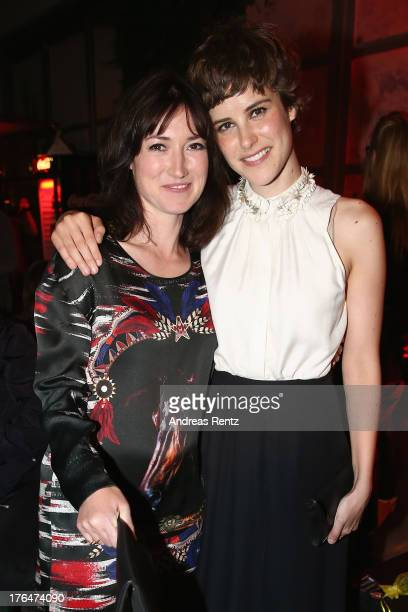 Writer Charlotte Roche and actress Carla Juri attend 'Feuchtgebiete' Germany Premiere after show party at Gretchen on August 13 2013 in Berlin Germany