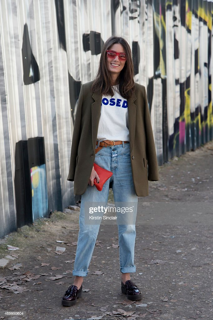 Writer Chloe Sachdev wears a Closed tshirt jacket and jeans Truffle shoes Burberry sunglasses and Comme Des Garcons bag on day 6 of Paris Collections...