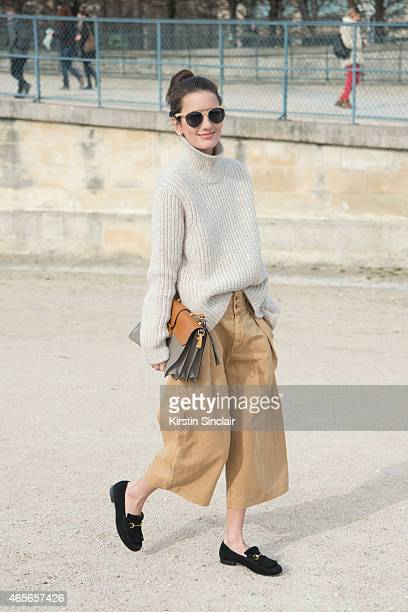 Writer Chloe Sachdev wears Gucci shoes Closed trousers and sweater and Miu Miu bag on day 5 of Paris Collections Women on March 07 2015 in Paris...