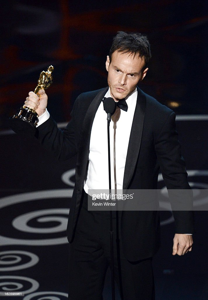Writer Chris Terrio accepts the Best Writing Adapted Screenplay for 'Argo' onstage during the Oscars held at the Dolby Theatre on February 24 2013 in...