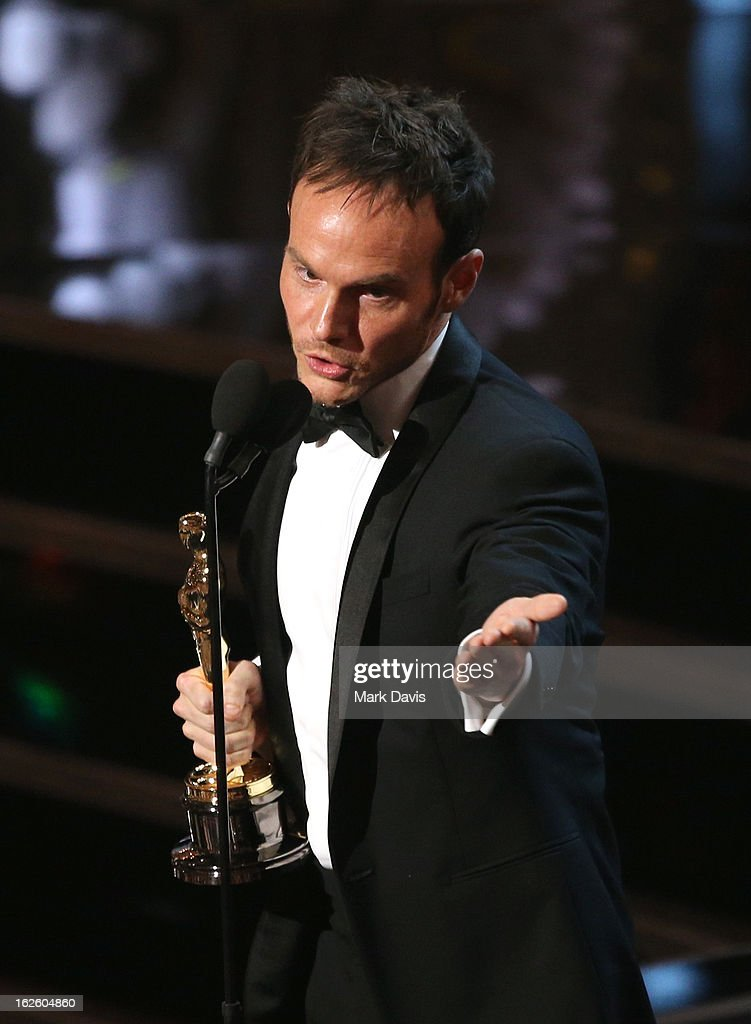 Writer Chris Terrio accepts the Best Writing - Adapted Screenplay for 'Argo' onstage during the Oscars held at the Dolby Theatre on February 24, 2013 in Hollywood, California.