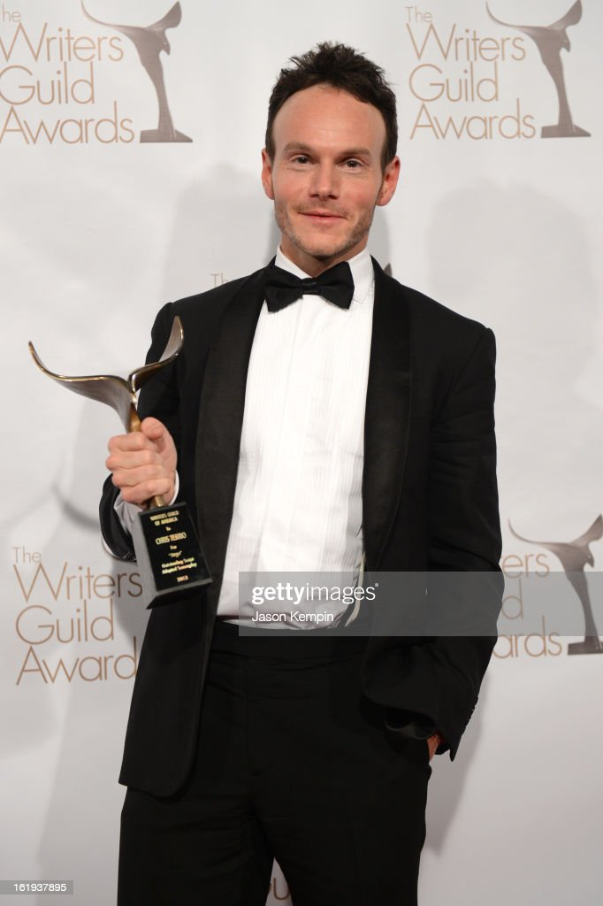 Writer Chris Terrio winner of the Writers Guild Award for Outstanding Script Adapted Screenplay poses in the press room during the 2013 WGAw Writers...