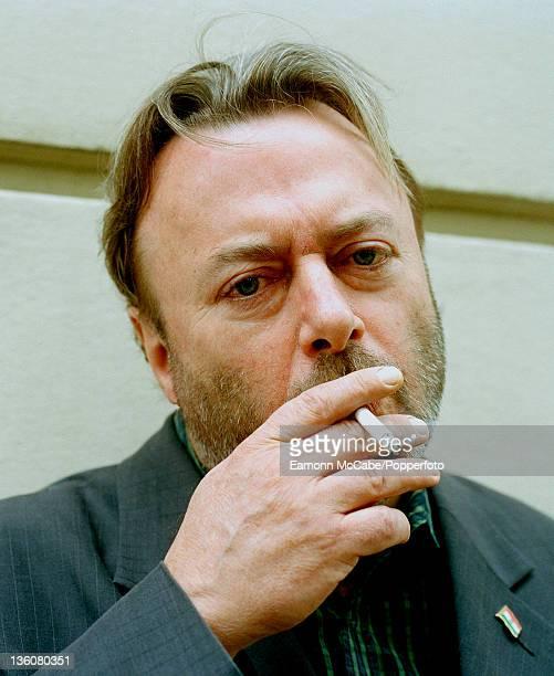 Writer Christopher Hitchens portrait smoking a cigarette London circa 2000 Photo by Eamonn McCabe