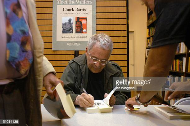 Writer Chuck Barris signs copies of his new book 'Bad Grass Never Dies' during a book signing June 30 2004 in New York City