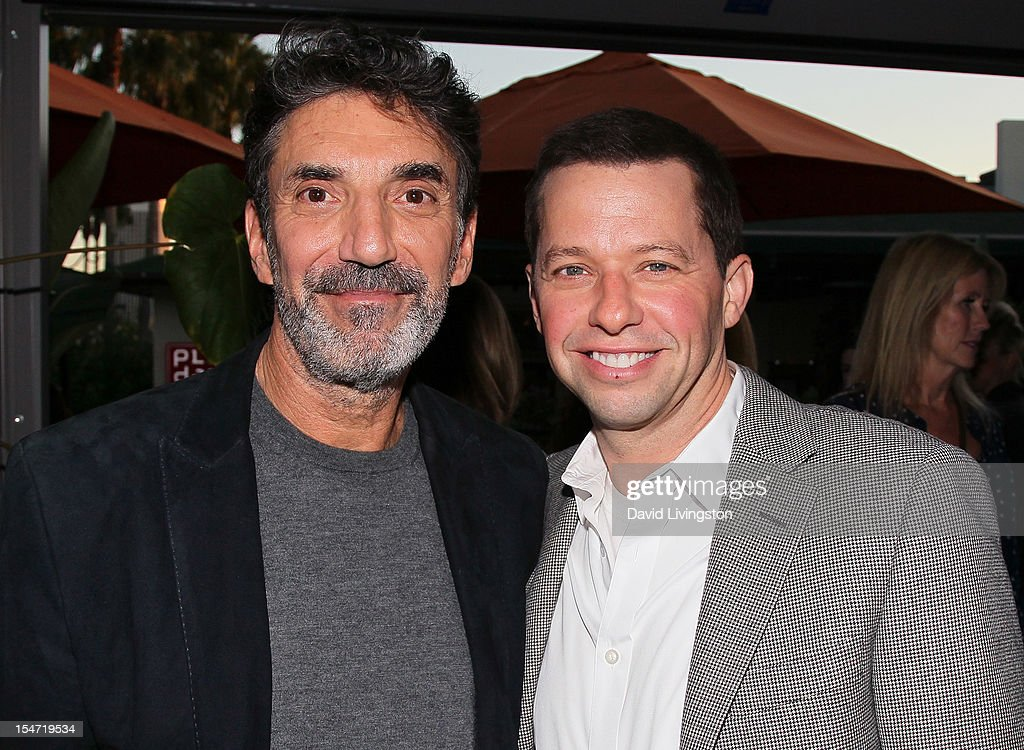 Writer Chuck Lorre (L) and actor Jon Cryer attend a reception to celebrate the release of Lorre's 'What Doesn't Kill Us Makes Us Bitter' at Mixology101 & Planet Dailies on October 24, 2012 in Los Angeles, California.