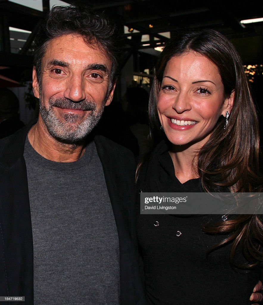 Writer Chuck Lorre (L) and actress Emmanuelle Vaugier attend a reception to celebrate the release of Lorre's 'What Doesn't Kill Us Makes Us Bitter' at Mixology101 & Planet Dailies on October 24, 2012 in Los Angeles, California.