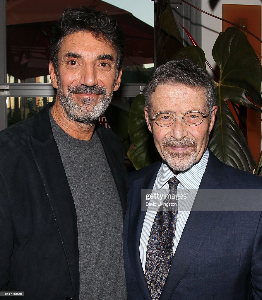 Writer Chuck Lorre (L) and Warner Bros. Entertainment Chairman/CEO Barry Meyer attend a reception to celebrate the release of Lorre's 'What Doesn't Kill Us Makes Us Bitter' at Mixology101 & Planet Dailies on October 24, 2012 in Los Angeles, California.