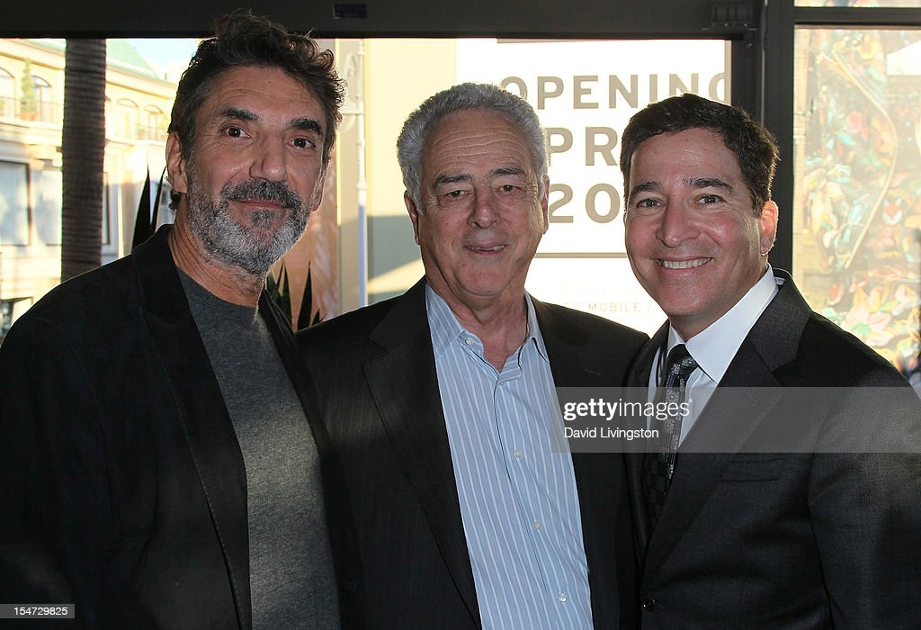 Writer Chuck Lorre, production executive Bob Broder and Warner Bros. Television Group president Bruce Rosenblum attend a reception to celebrate the release of Lorre's 'What Doesn't Kill Us Makes Us Bitter' at Mixology101 & Planet Dailies on October 24, 2012 in Los Angeles, California.