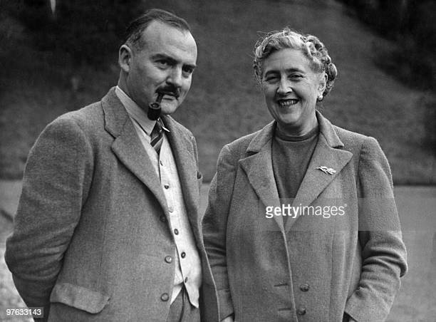 Writer Dame Agatha Christie and her husband Max E L Mallowan pose in March 1946 in the ground of their home Greenway House in Devonshire Agatha...