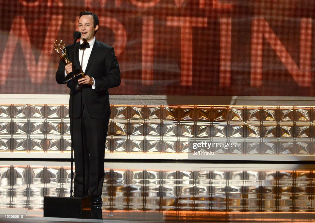 Writer Danny Strong accept his award onstage during the 64th Primetime Emmy Awards at Nokia Theatre L.A. Live on September 23, 2012 in Los Angeles, California.