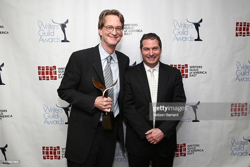 Writer David Koepp (L) and guest pose backstage at the 65th annual Writers Guild East Coast Awards at B.B. King Blues Club & Grill on February 17, 2013 in New York City.