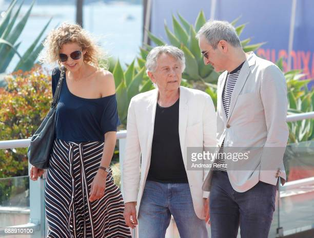 Writer Delphine de Vigan Director Roman Polanski and Screenwriter Olivier Assayas attend the 'Based On A True Story' photocall during the 70th annual...