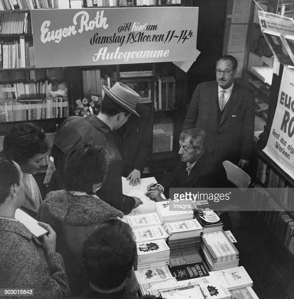 Writer Eugen Roth signs books in a bookstore Photograph Ca 1970