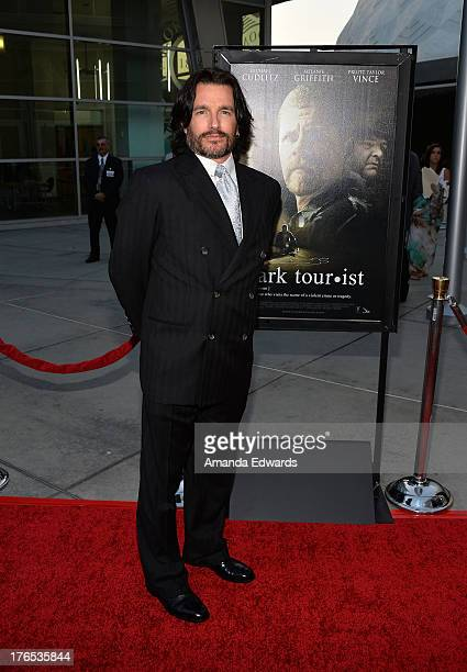 Writer Frank John Hughes arrives at the premiere of 'Dark Tourist' at ArcLight Hollywood on August 14 2013 in Hollywood California