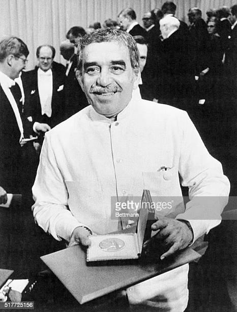 Writer Gabriel Garcia Marquez holding his Nobel Prize for Literature medal after the award ceremony in Stockholm Sweden
