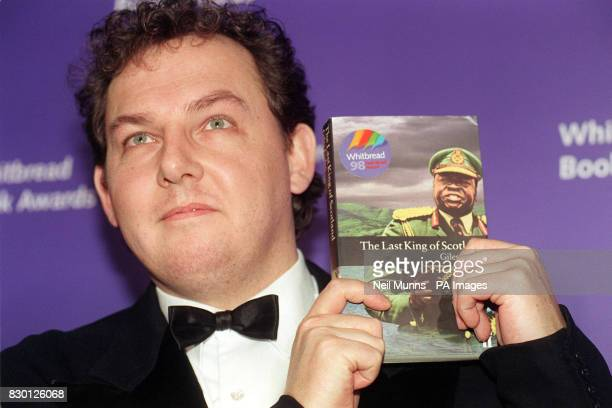 Writer Giles Foden who won the Whitbread First Novel Award for his book 'The Last King of Scotland' holds up a copy of it at the ceremony in London