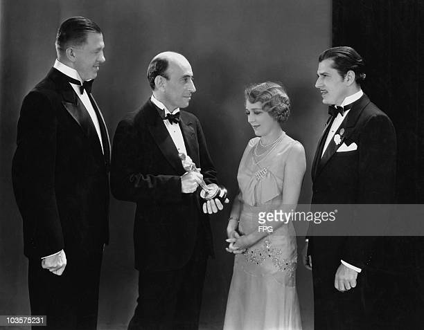 Writer Hanns Kraly President of the Academy of Motion Picture Arts and Sciences William C DeMille actress Mary Pickford and actor Warner Baxter...