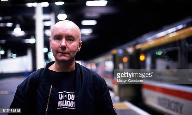 Writer Irvine Welsh at a railway station in London 1995