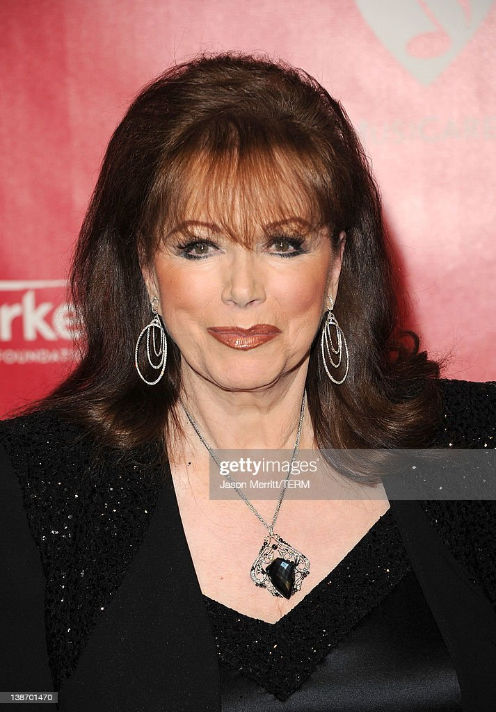 Writer <a gi-track='captionPersonalityLinkClicked' href=/galleries/search?phrase=Jackie+Collins&family=editorial&specificpeople=123843 ng-click='$event.stopPropagation()'>Jackie Collins</a> arrives at the 2012 MusiCares Person of the Year Tribute To Paul McCartney held at the Los Angeles Convention Center on February 10, 2012 in Los Angeles, California.