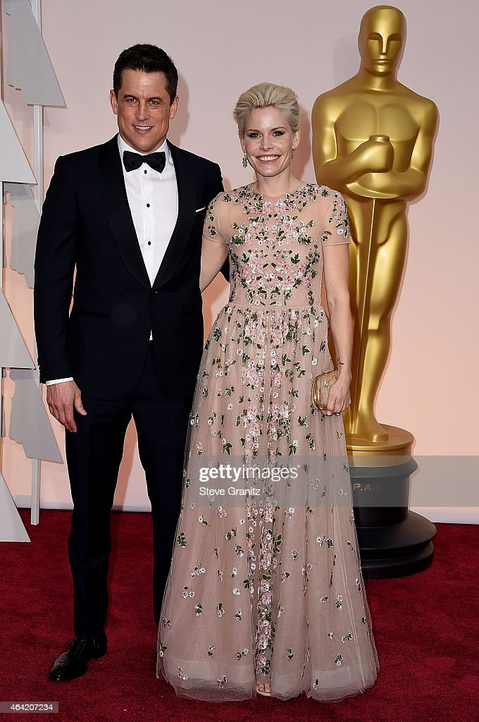 Writer Jason Hall and Elisha Hall attend the 87th Annual Academy Awards at Hollywood & Highland Center on February 22, 2015 in Hollywood, California.