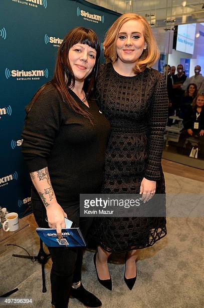 Writer Jenny Eliscu and singer Adele pose in the studio as Adele goes one on one with fans during an exclusive SiriusXM Town Hall Special in the...