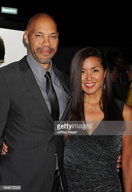 Writer John Ridley and his wife Gayle Ridley arrive at the Los Angeles premiere of '12 Years A Slave' at Directors Guild Of America on October 14...