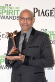 Writer John Ridley poses with the award for Best Screenplay for '12 Years a Slave' in the press room during the 2014 Film Independent Spirit Awards...