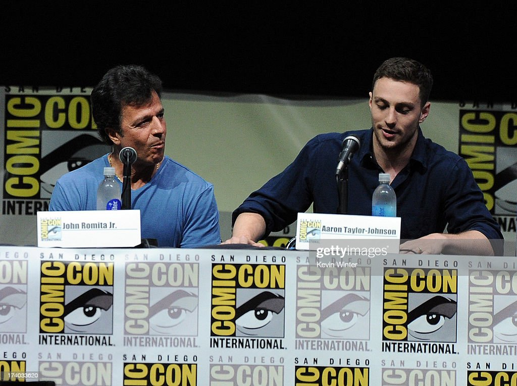 Writer John Romita Jr. (L) and actor Aaron Taylor-Johnson speaks onstage at the 'Kick-Ass 2' and 'Riddick' Panels during Comic-Con International 2013 at San Diego Convention Center on July 19, 2013 in San Diego, California.