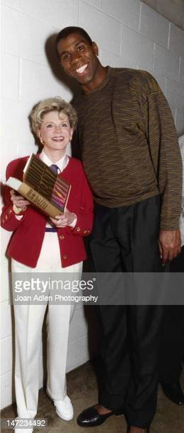 Writer Judith Krantz presenting her most recent novel DAZZLE to Magic Johnson to whom she dedicated her book to along with the Los Angeles Lakers In...
