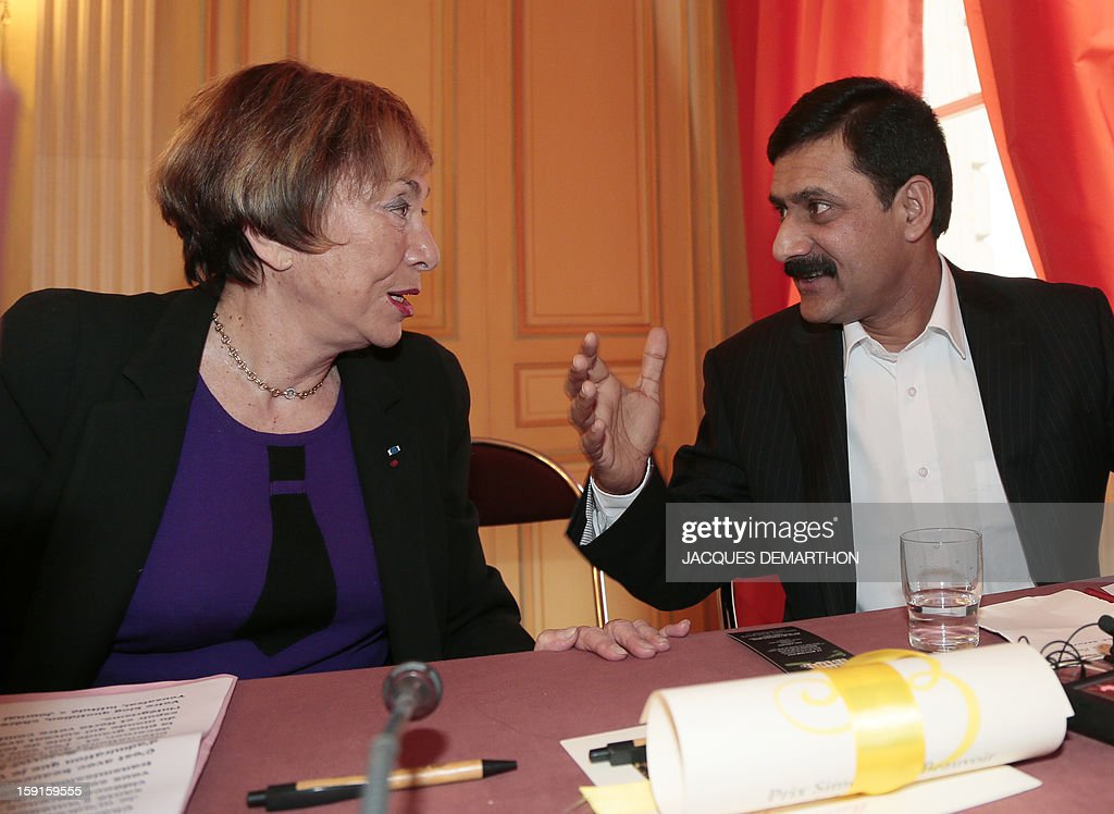 Writer Julia Kristeva (L) speaks, on January 9, 2013, in Paris, during the Simone de Beauvoir awards ceremony, with Ziauddin Yousafzai, the father of Malala Yousafzai, the young Pakistani schoolgirl and activist who was the victim of an assasination attempt by the Taliban in 2012. The 2013 Simone de Beauvoir prize for the freedom of women was handed to Malala Yousafzai, who has become a symbol of the struggle for girls' education and women's rights in Pakistan. Malala was flown to the United Kingdom with a life-threatening head wound shortly after her attack but recovered from her injuries and was temporarily discharged on January 4 as she awaits more surgery.