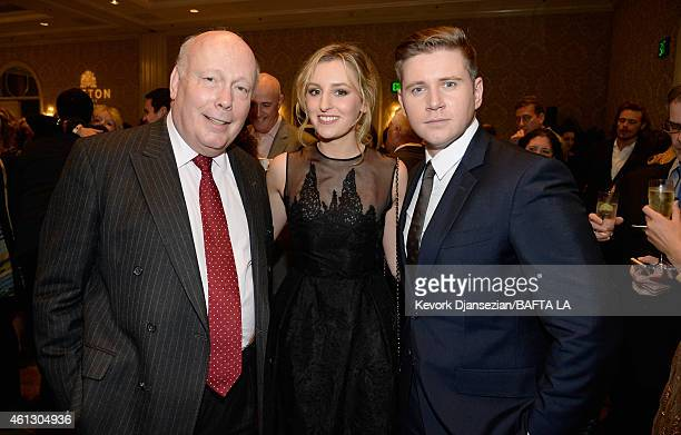 Writer Julian Fellowes actress Laura Carmichael and Allen Leech in Mulberry attend the BAFTA Los Angeles Tea Party at The Four Seasons Hotel Los...