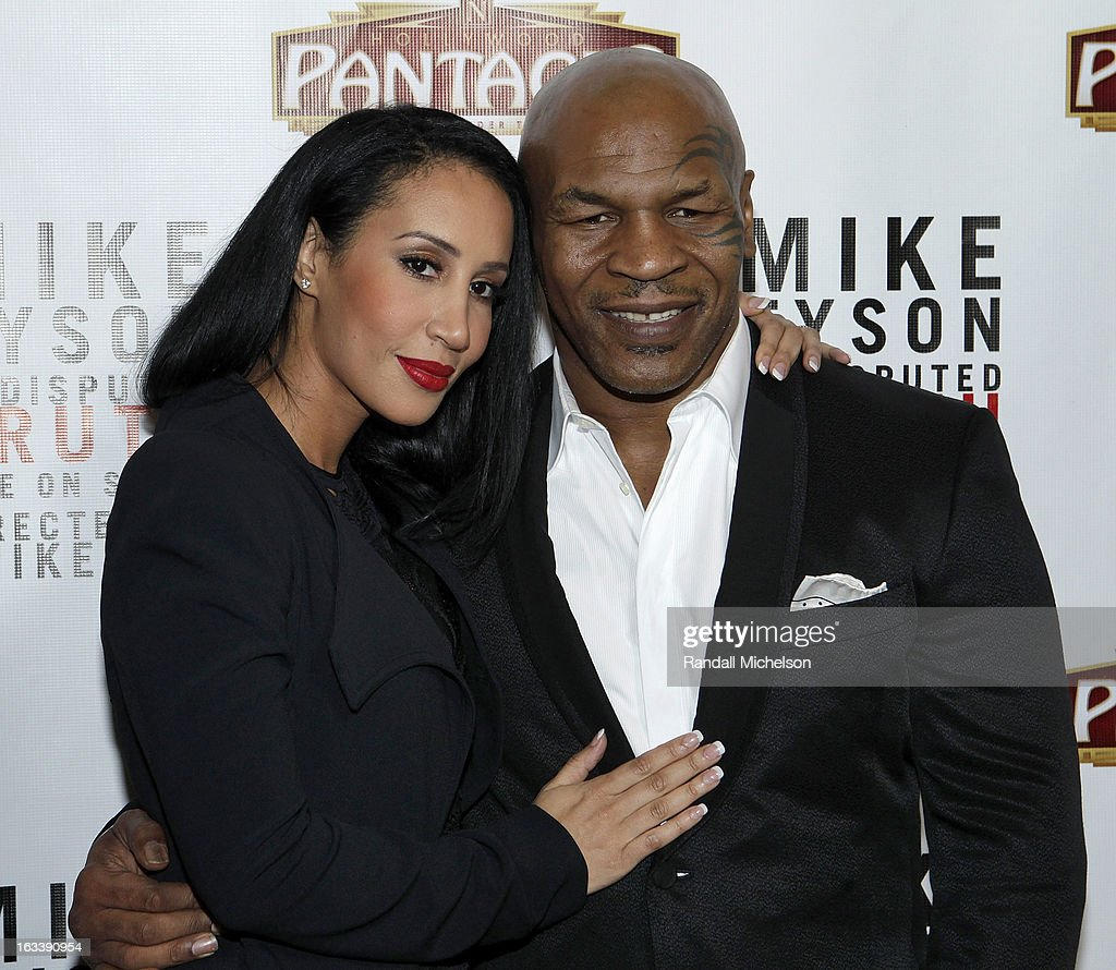 Writer Kiki Tyson and <a gi-track='captionPersonalityLinkClicked' href=/galleries/search?phrase=Mike+Tyson&family=editorial&specificpeople=194986 ng-click='$event.stopPropagation()'>Mike Tyson</a> attend the Los Angeles Premiere of '<a gi-track='captionPersonalityLinkClicked' href=/galleries/search?phrase=Mike+Tyson&family=editorial&specificpeople=194986 ng-click='$event.stopPropagation()'>Mike Tyson</a> - Undisputed Truth' at the Pantages Theatre on March 8, 2013 in Hollywood, California.