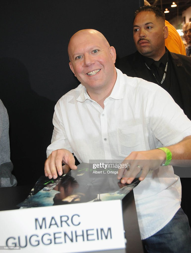 Writer Marc Guggenheim of The WB's 'Arrow' signs autographs at the DC Comics booth at WonderCon Anaheim 2013 - Day 3 held at Anaheim Convention Center on March 31, 2013 in Anaheim, California.