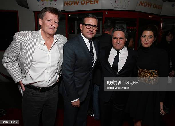 Writer Michael Lewis actor Steve Carell chairman and CEO of Paramount Pictures Brad Grey and actress Marisa Tomei attend the closing night gala...