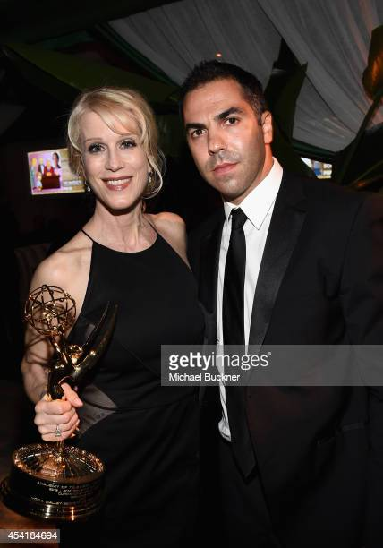 Writer Moira WalleyBeckett and guest attend the FOX 20th Century FOX Television FX Networks and National Geographic Channel's 2014 Emmy Award Nominee...